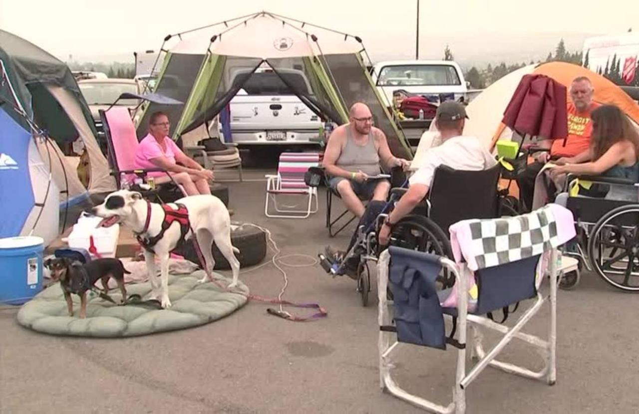 California fire evacuees shelter in parking lot