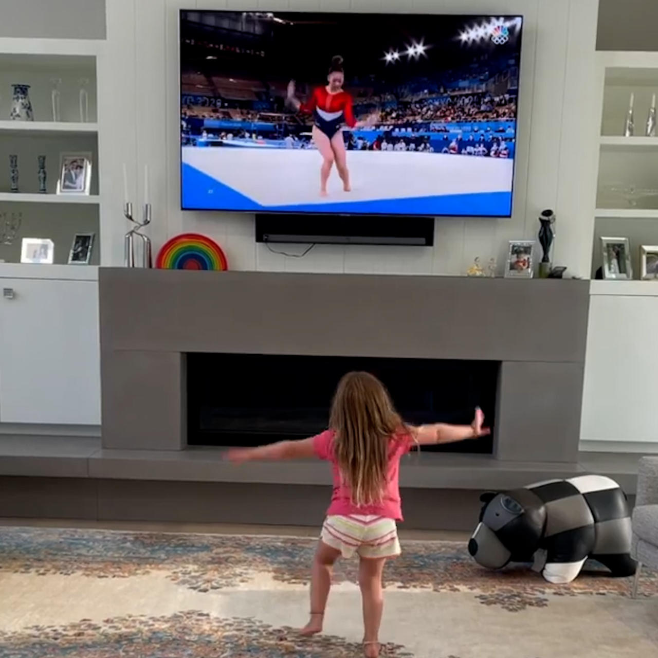 Little girl copies gymnasts gold medal routine