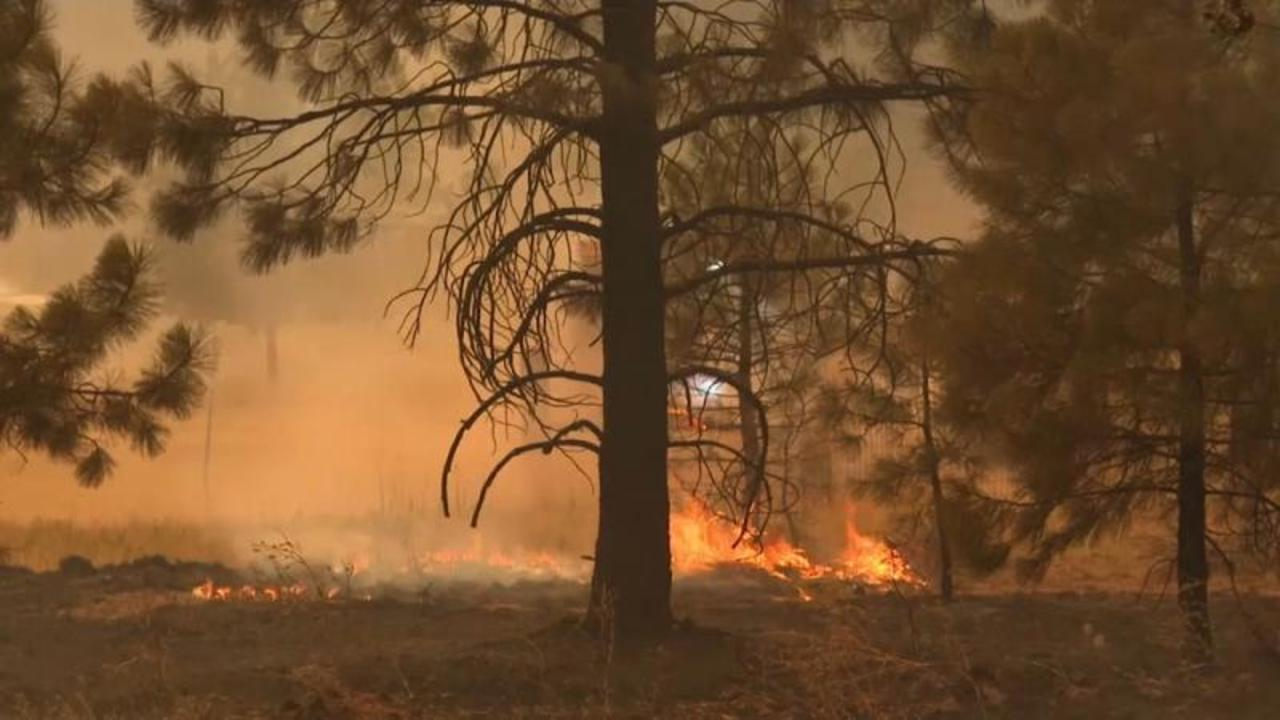 Dozens of California fires threaten thousands of homes and whole towns