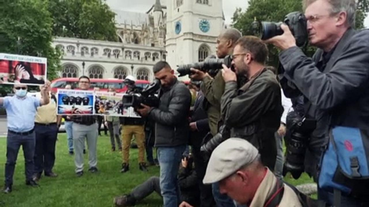 Demonstrations take place outside of British parliament to call for support for Afghans