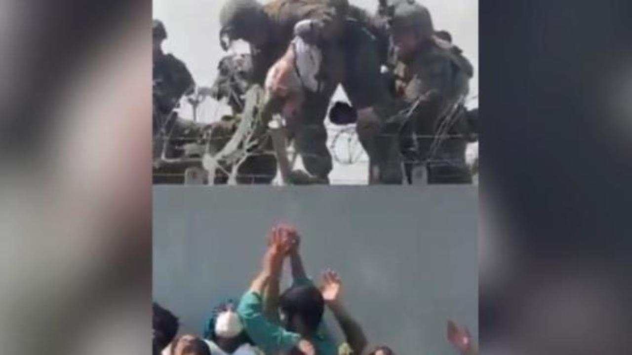 Video shows baby being handed over Kabul airport wall to US troops