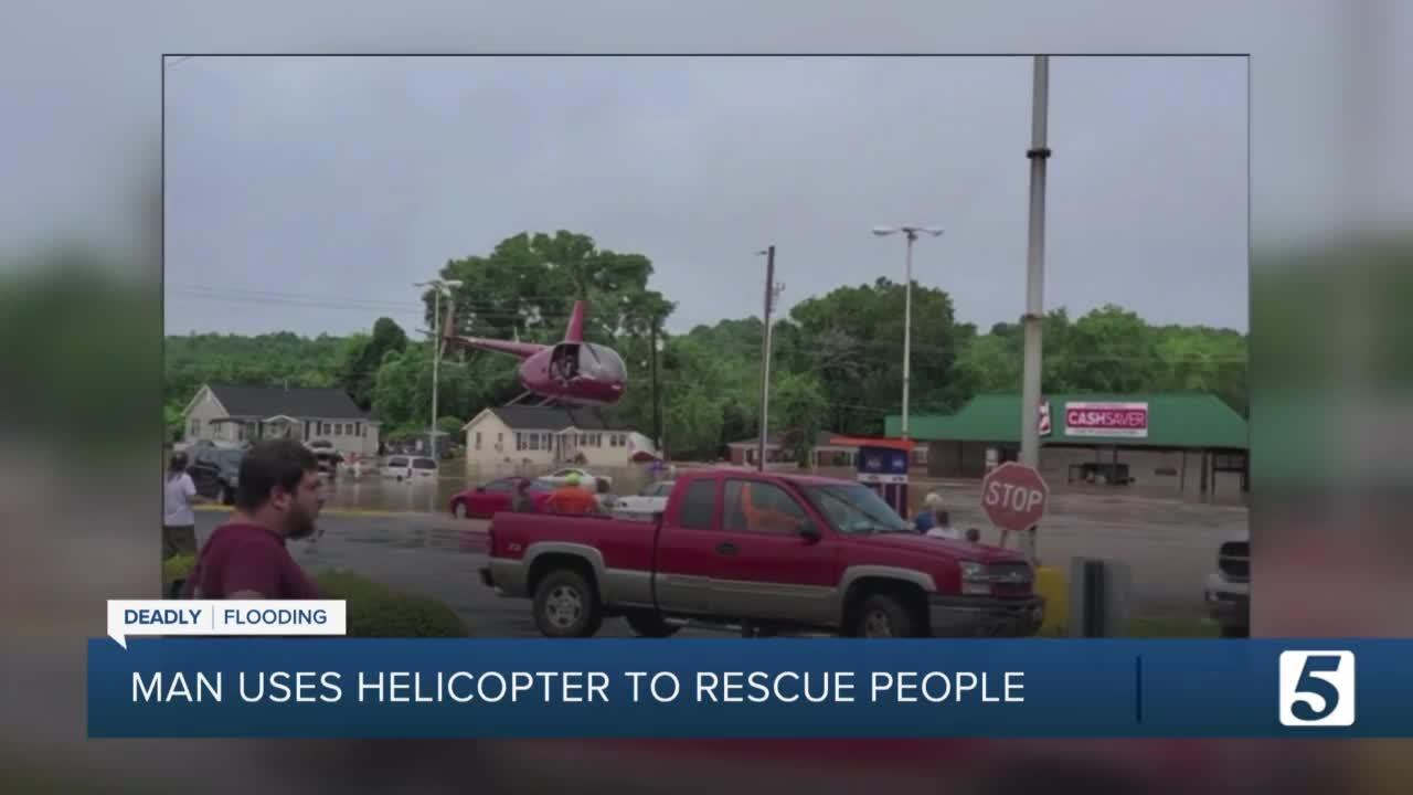 Man uses helicopter to rescue people stranded in flood