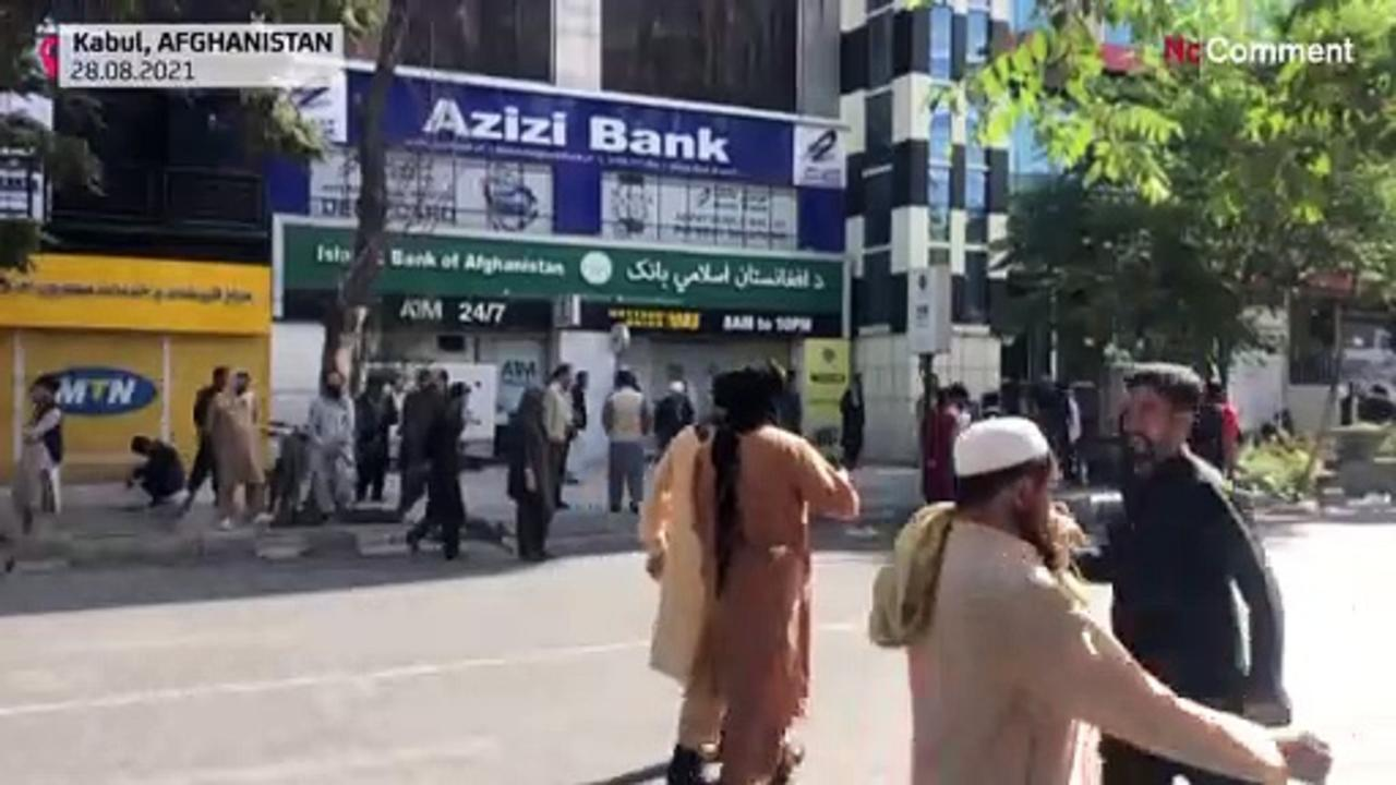 Protesters rally outside closed banks in Kabul
