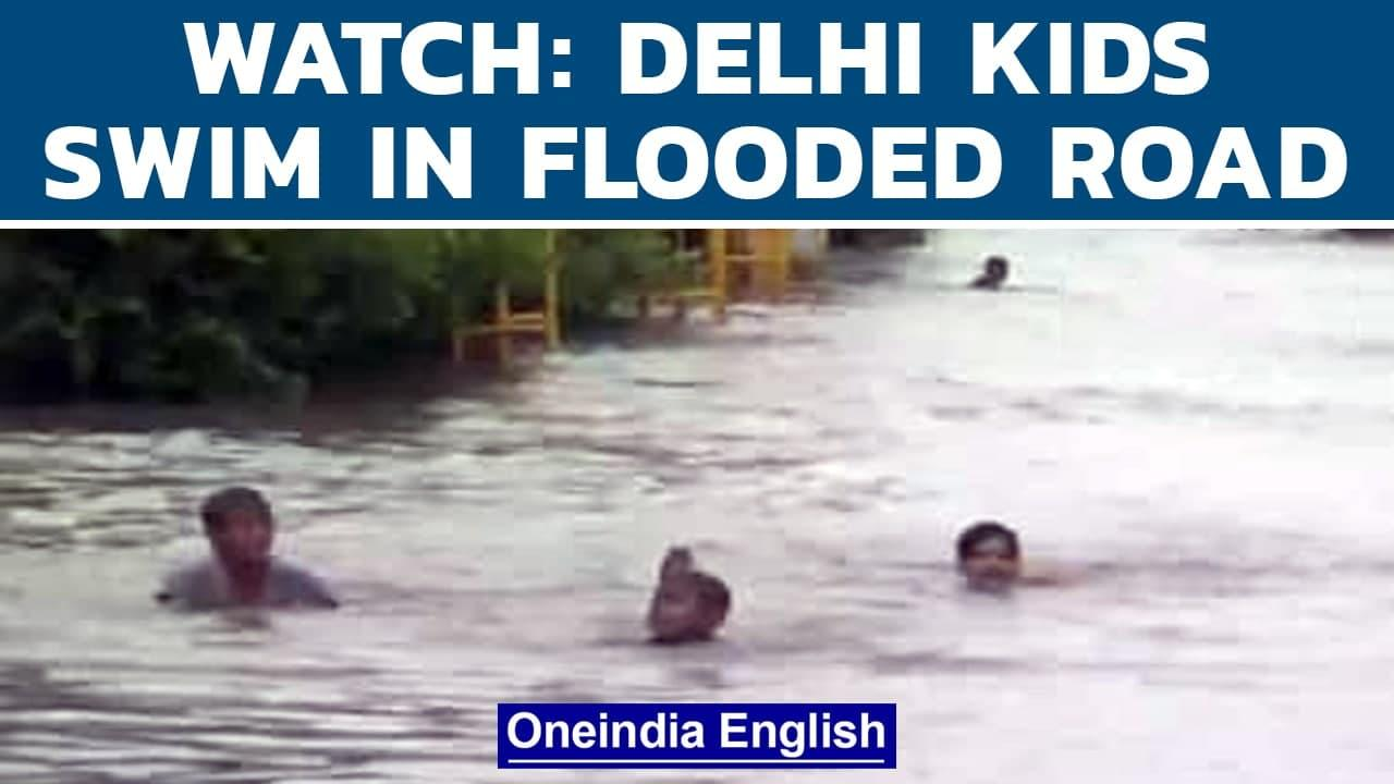 Delhi rain: Children seen swimming and playing on flooded streets   Delhi Airport   Oneindia News