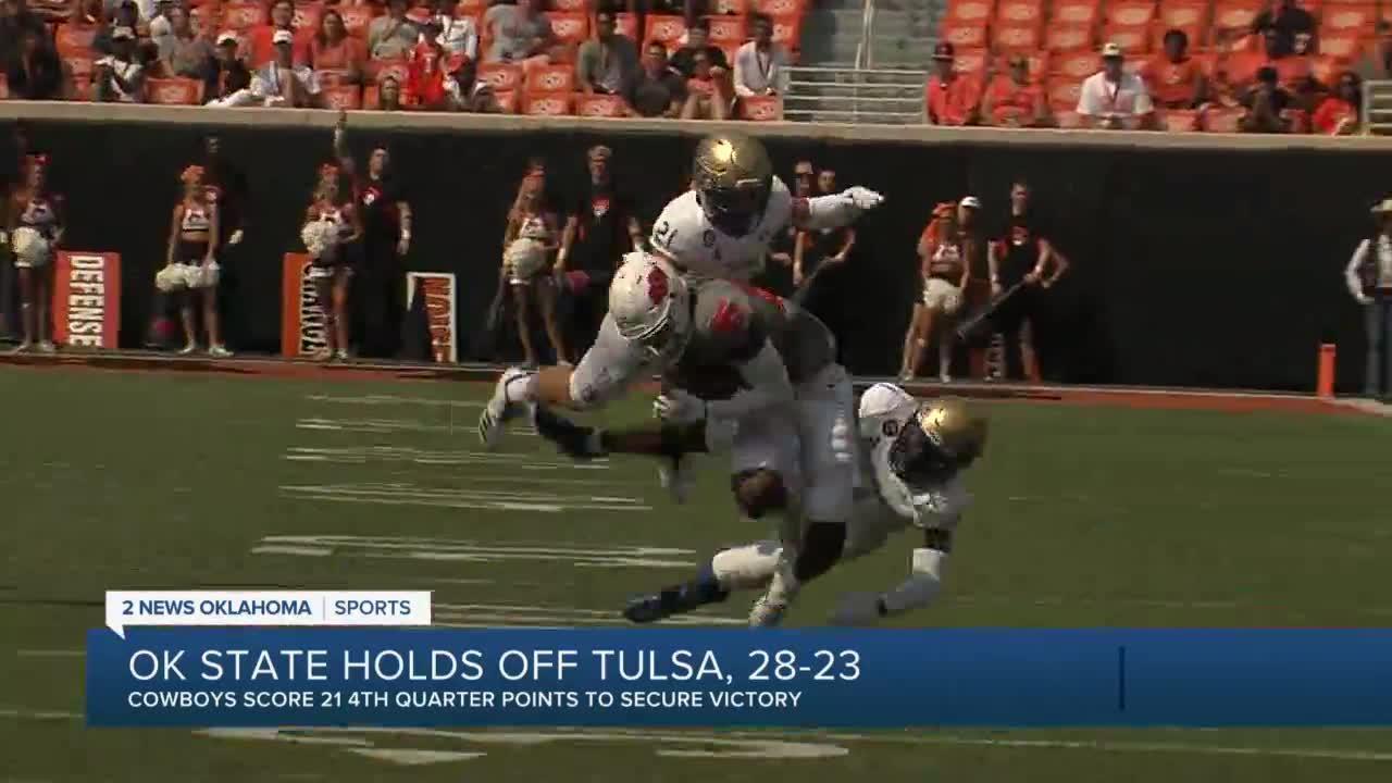 Oklahoma St holds off rival Tulsa 28-23 in Sanders' return