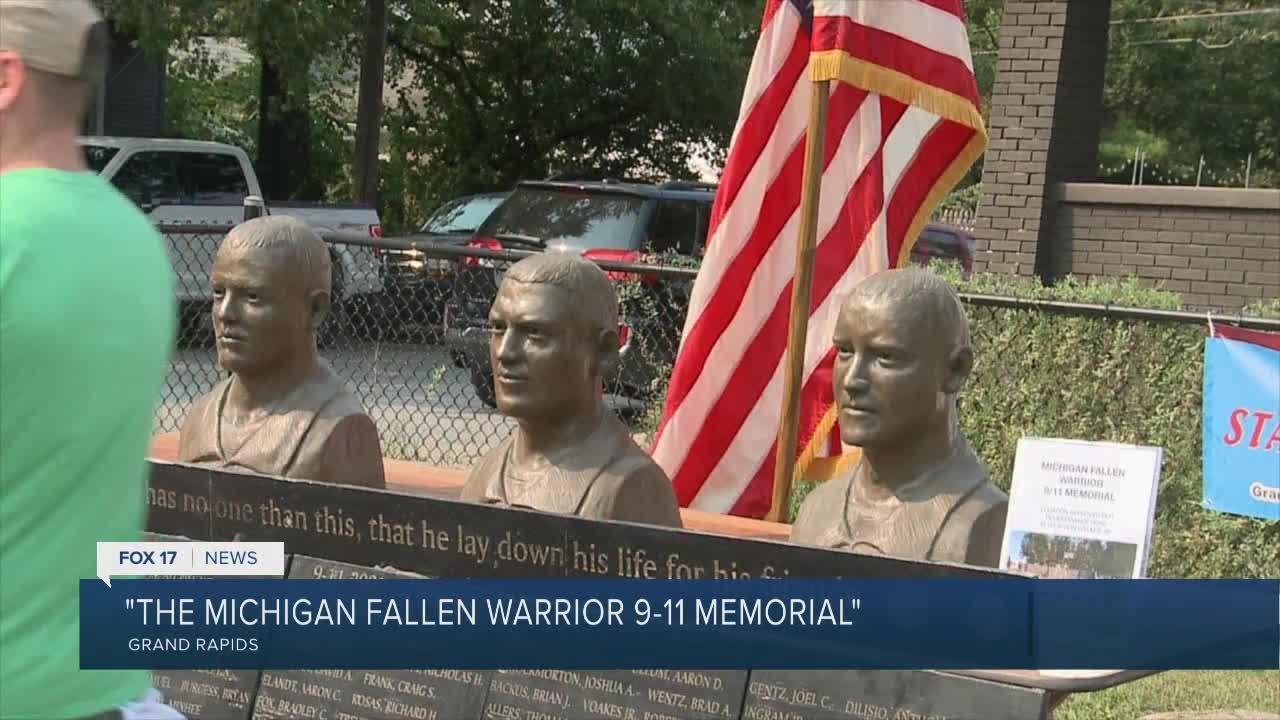 Sculpture of fall service members on display