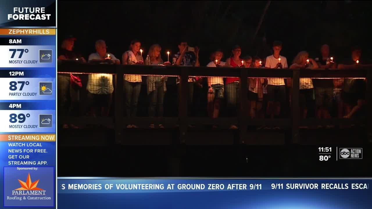 Candlelight vigil honors 9/11 victims and 13 soldiers killed in Kabul airport bombing