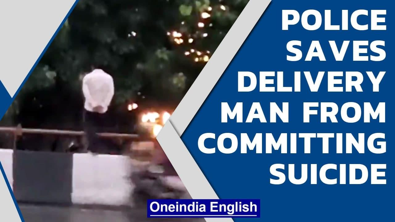 Delhi police saves delivery man from committing suicide   Oneindia News