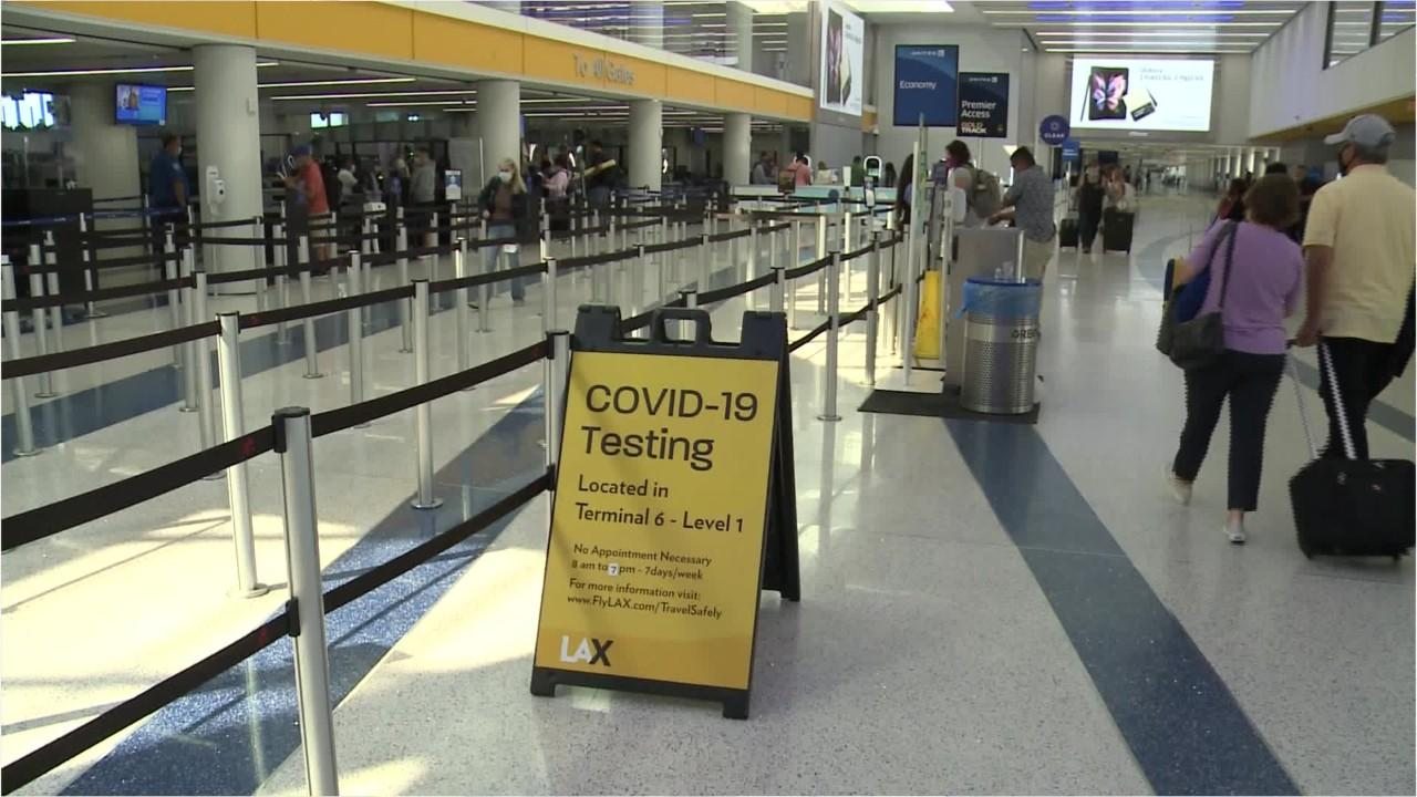 Travelers in face masks at LAX Airport on September 3 (S)