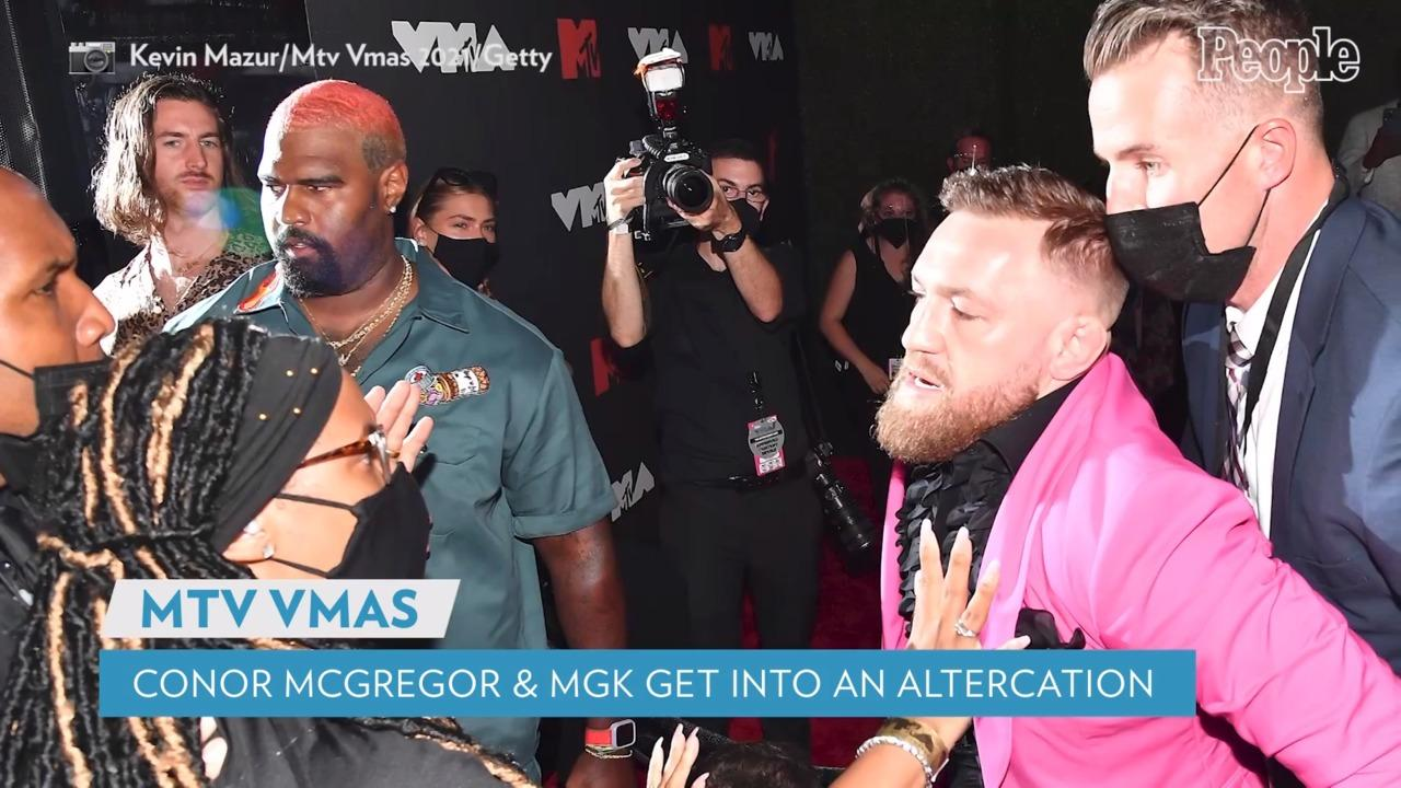 Conor McGregor Takes a Swing at Machine Gun Kelly with His Cane During Altercation on VMAs Red Carpet