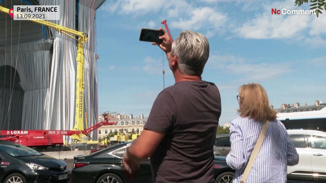 Parisians, tourists admire wrapping of Arc de Triomphe, tribute to Christo