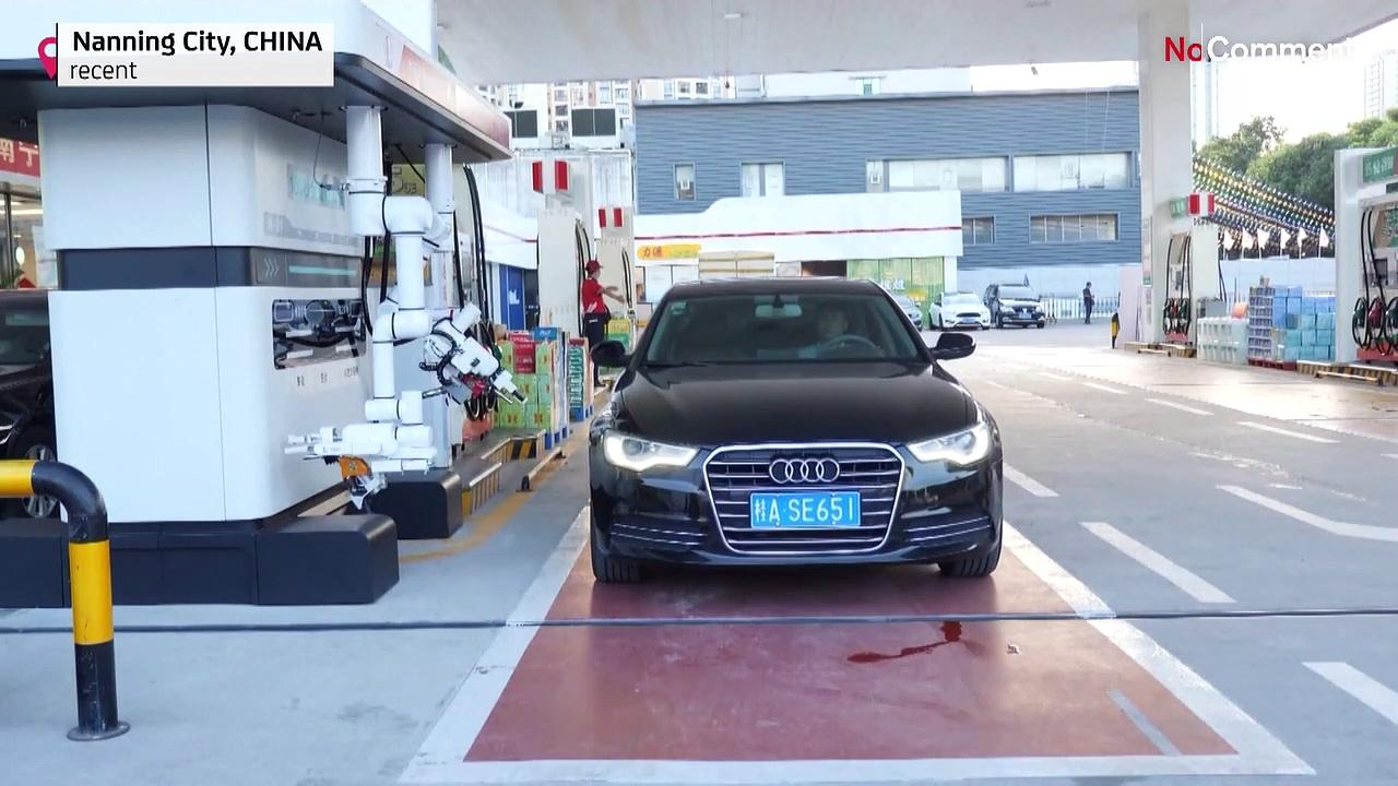 A robot that can pump gas is being piloted at a filling station in southern China