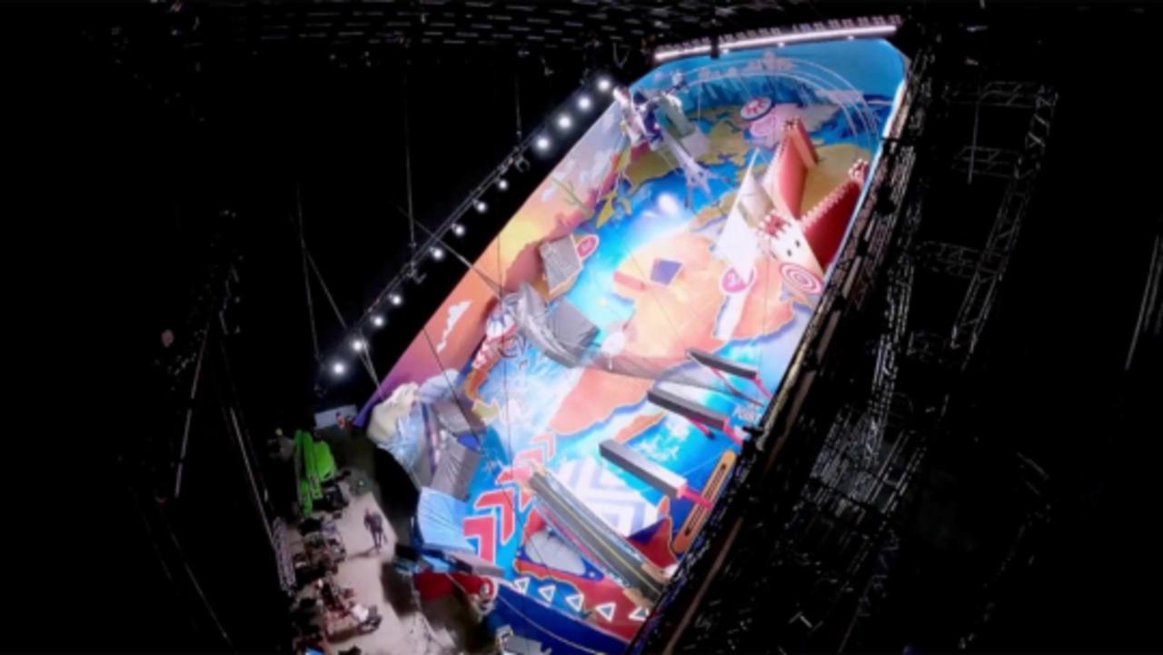 Stuntman Gets Knocked Around in 4 Story Tall Pinball Machine