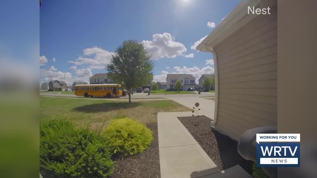 UPS truck passes school bus