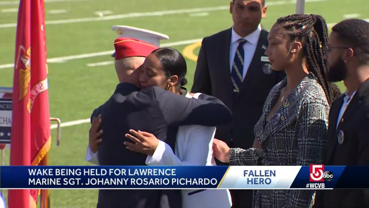 Gold Star families embrace as final respects paid to fallen Marine