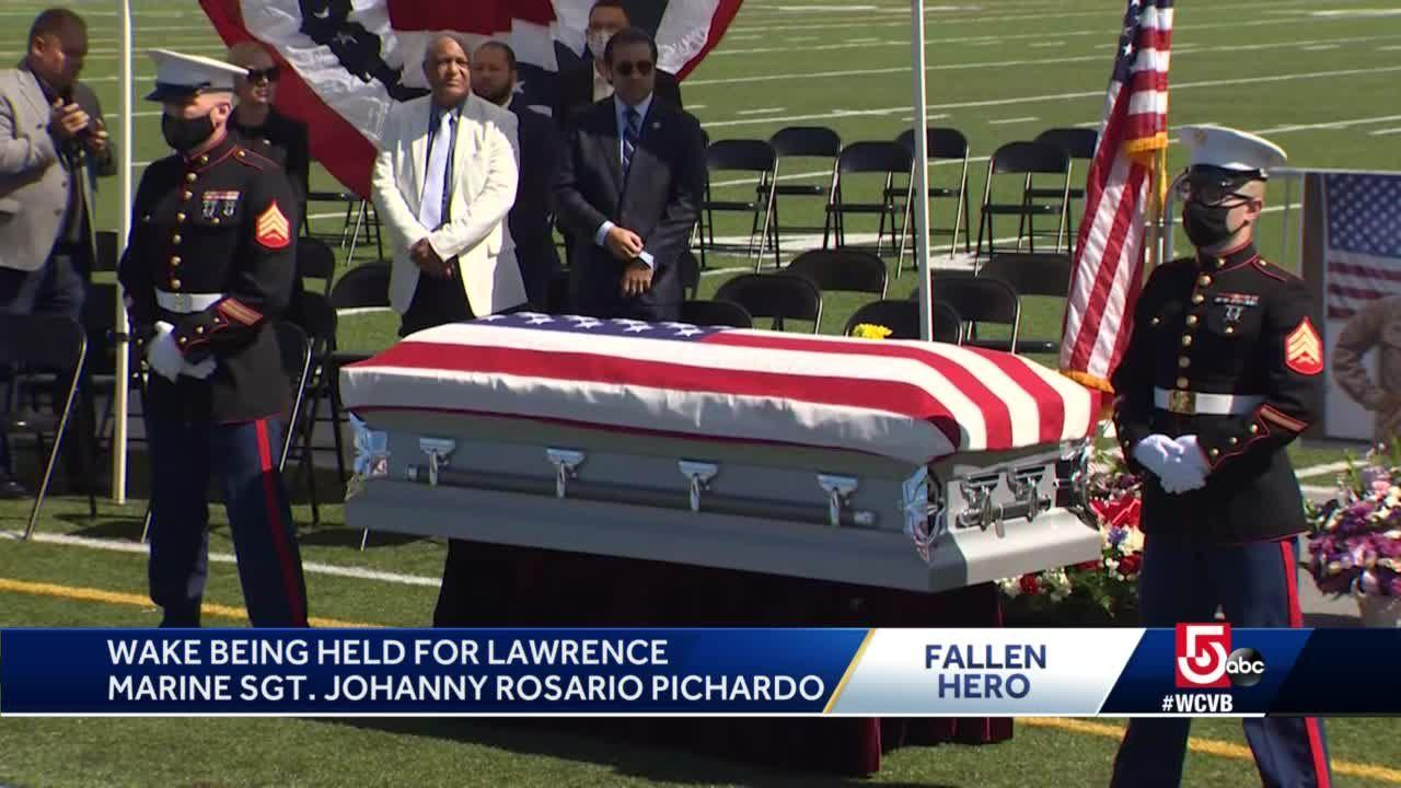 Thousands paying respects to fallen Lawrence marine