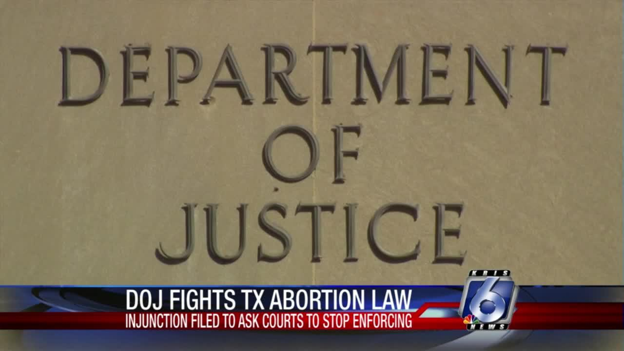 Justice Department asks judge to block abortion law