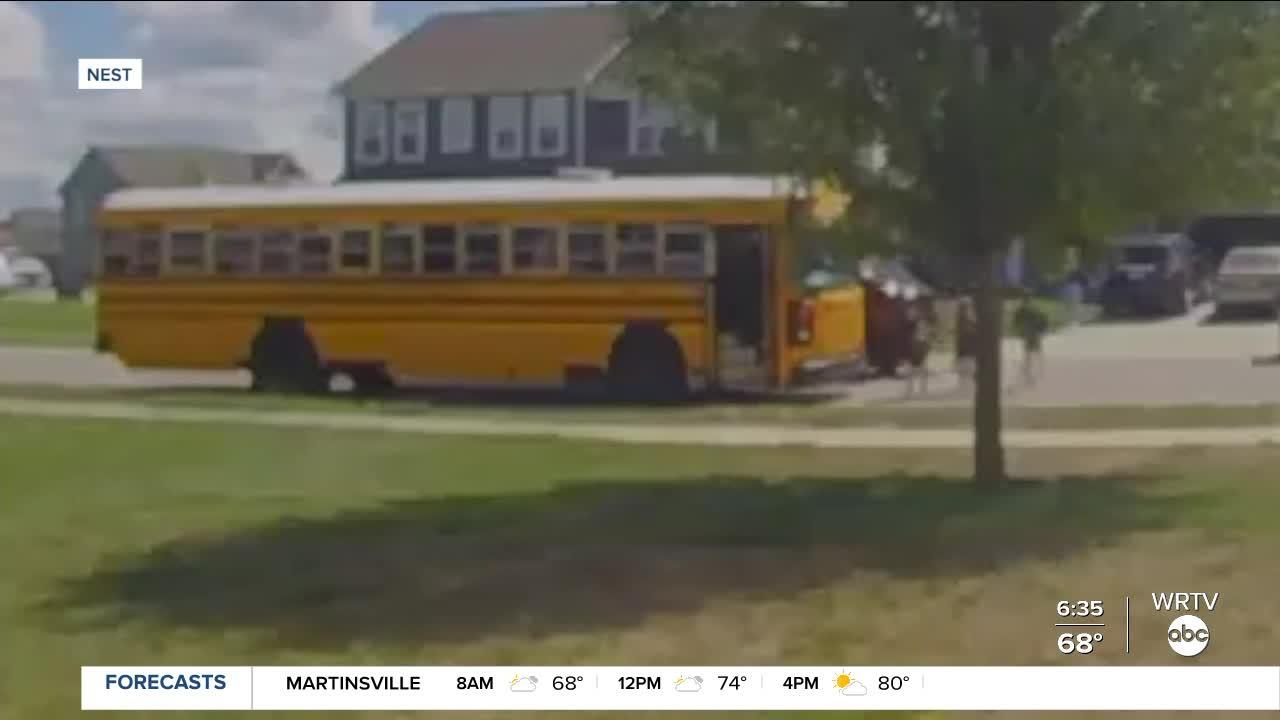 UPS driver nearly hits kids getting off school bus