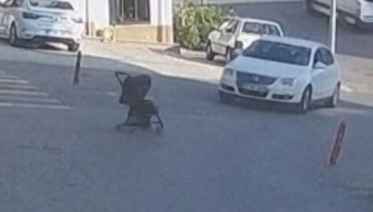Heart-stopping Footage Of Baby in Stroller Nearly Getting Hit By Car