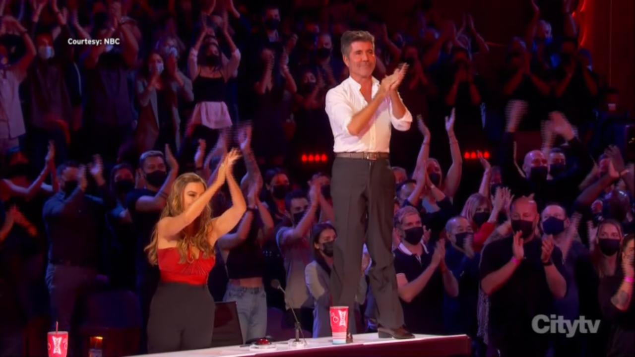 'AGT' Final: Simon Cowell Climbs On Judges Desk To Applaud Aerialist's Performance