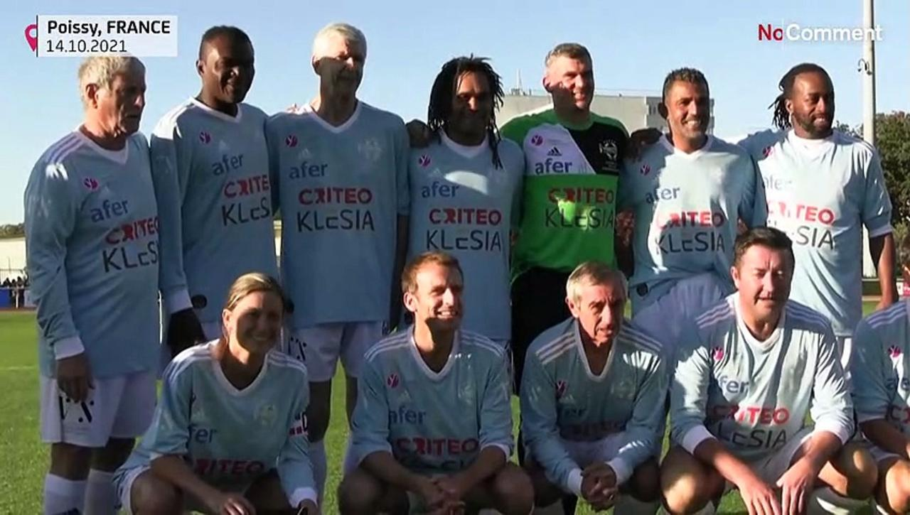 Emmanuel Macron scores penalty during charity football match