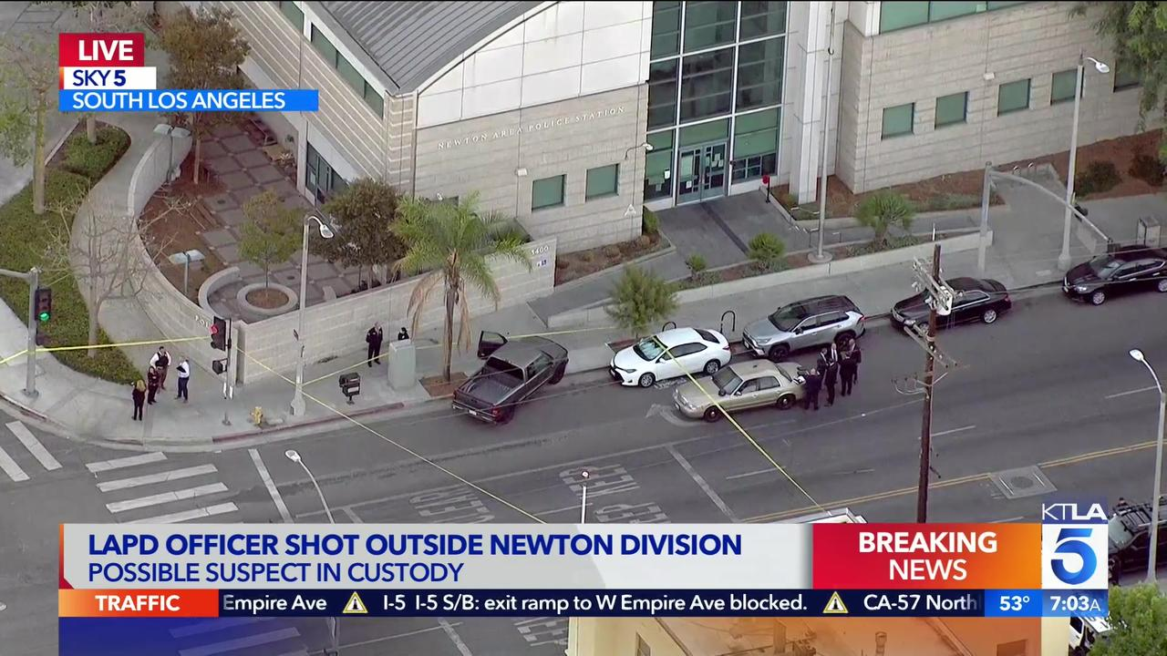 LA officer shot near police station; 14-year-old said to be in custody