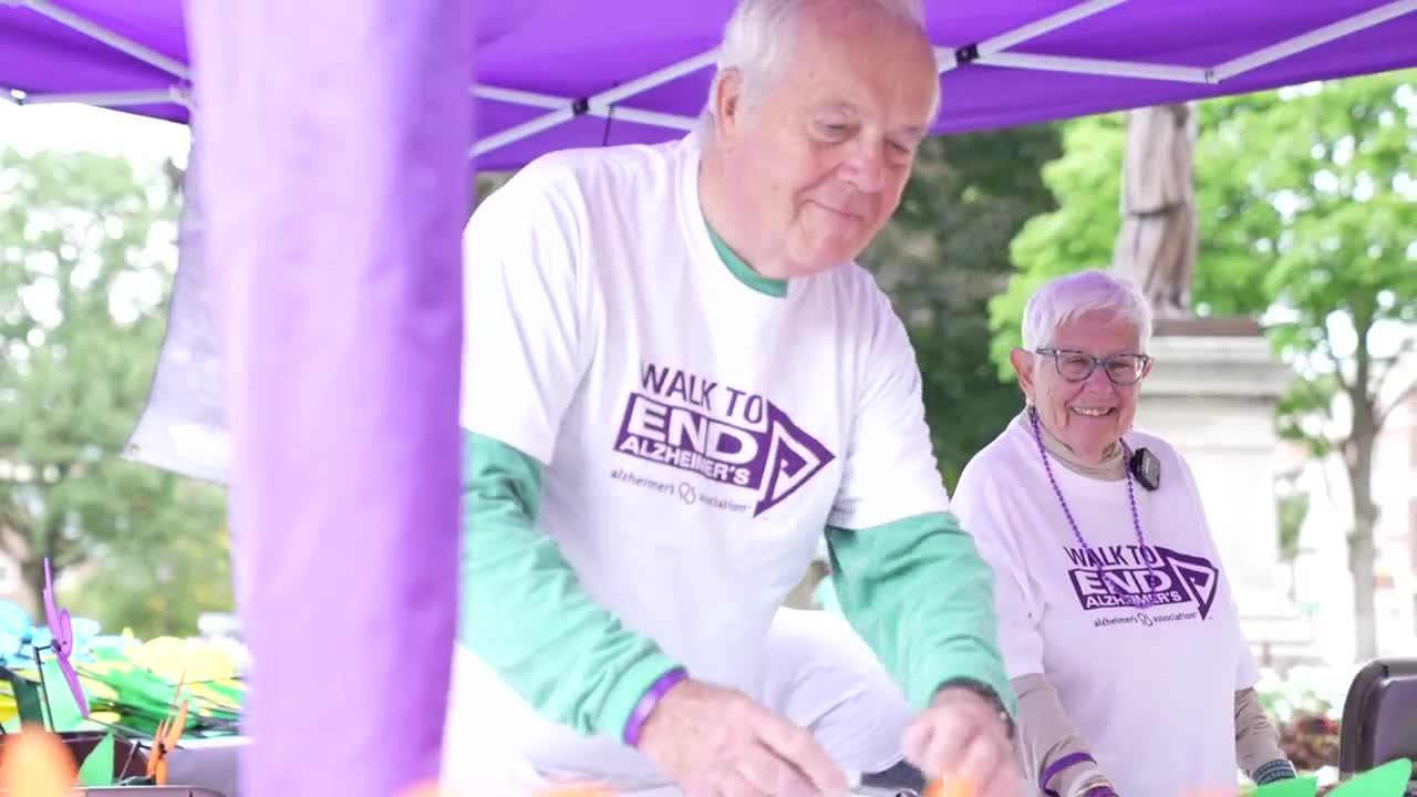 Volunteers help raise awareness and funds for Alzheimer's Disease.